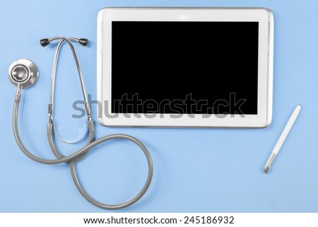 Unique Perspectives of medical tablet with black screen, stethoscope, and stylus pen - stock photo