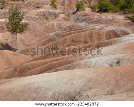 Unique red desert soil formation at the Cheltenham Badlands near Toronto, Ontario, Canada - stock photo