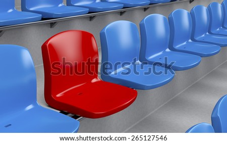 Unique red seat among blue ones - stock photo