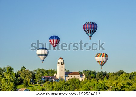 Unique view of hot air ballons around the Boise Train Depot - stock photo
