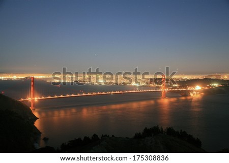 Unique Views of the World Famous Golden Gate Bridge and San Francisco California at dusk and the dead of night. People travel from around the world to visit this world famous land mark and city. - stock photo