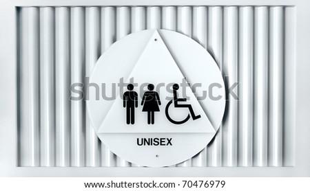 Unisex and handicapped sign on public restroom door - stock photo