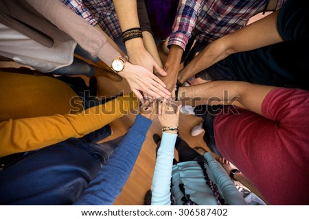 Unit and concord in multiethnic team, all hands together  - stock photo