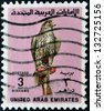 UNITED ARAB EMIRATES - CIRCA 1987: A stamp printed in the United Arab Emirates (UAE) shows image of a bird of prey, circa 1987 - stock photo