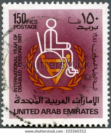 UNITED ARAB EMIRATES - CIRCA 1981: A stamp printed in UAE shows man in wheelchair, international year of disabled persons 1981, series, circa 1981 - stock photo