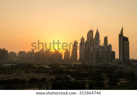 United Arab Emirates, Dubai, 07/02/2014, dubai marina dusty sunset cityscape silhouette  at sunset