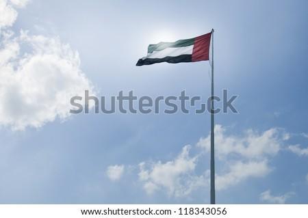 United Arab Emirates flag against sun - stock photo