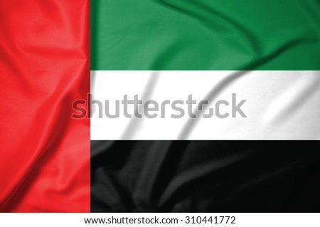 united arab emirates flag on soft and smooth silk texture - stock photo