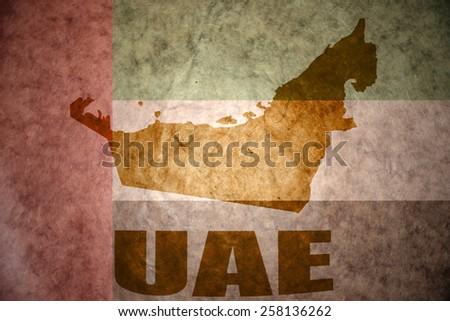 united arab emirates map on a vintage united arab emirates flag background - stock photo