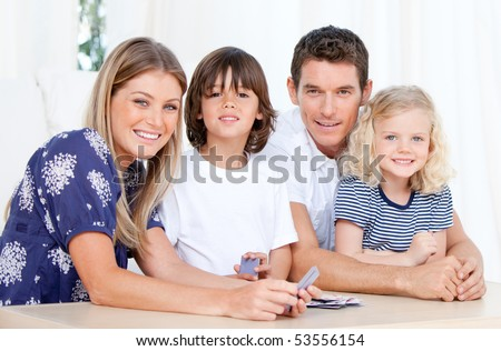 United family looking at the camera together at home - stock photo