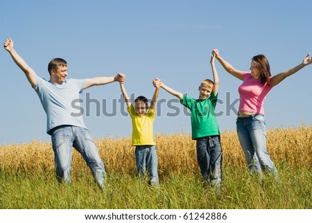 United family walkin in the wheat field