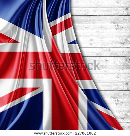 United flag Kingdom  and wood background - stock photo