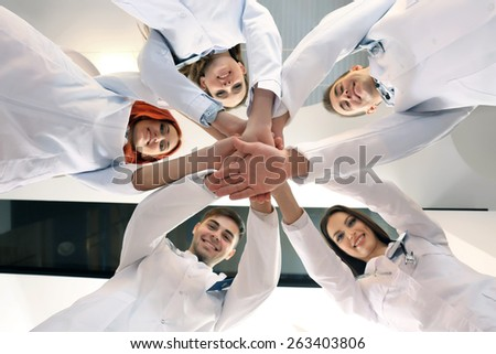 United hands of medical team close up - stock photo
