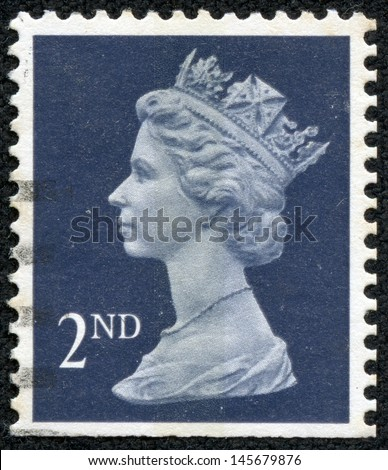 UNITED KINGDOM 1997: A used 1st Class postage stamp printed in Britain showing Portrait of Queen Elizabeth 2nd, circa 1997 - stock photo