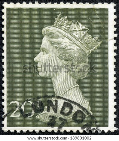 UNITED KINGDOM 1997: A used 1st Class postage stamp printed in Britain showing Portrait of Queen Elizabeth 2nd, circa 1997