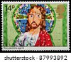 UNITED KINGDOM - CIRCA 1981: A British Used Christmas Postage Stamp showing Childrens Picture of Jesus Christ, circa 1981 - stock photo