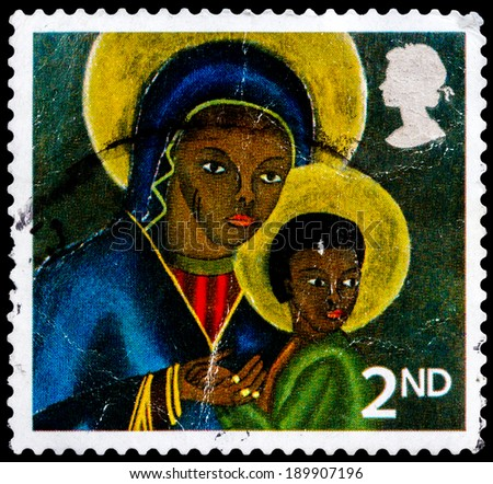 UNITED KINGDOM - CIRCA 2005: A British Used Postage Stamp showing Black Madonna and Child from Haiti, circa 2005  - stock photo