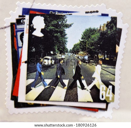 UNITED KINGDOM - CIRCA 2007: a postage stamp printed in Great Britain showing an image of The Beatles, Abbey Road album cover, circa 2007.  - stock photo