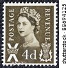 UNITED KINGDOM - CIRCA 1958: A postage stamp printed in Scotland shows a portrait of queen Elizabeth II, circa 1958. - stock photo