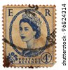 UNITED KINGDOM - CIRCA 1952: A postage stamp printed in United Kingdom showing a portrait of queen Elizabeth II, circa 1952. - stock photo