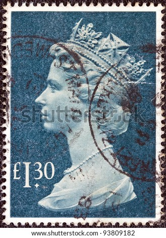 UNITED KINGDOM - CIRCA 1977: A postage stamp printed in United Kingdom showing a portrait of Queen Elizabeth II, circa 1977. - stock photo