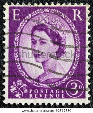 UNITED KINGDOM - CIRCA 1952: A postage stamp printed in United Kingdom shows a portrait of queen Elizabeth II, circa 1952. - stock photo