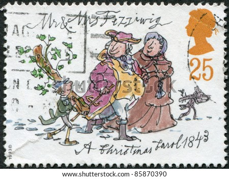 UNITED KINGDOM - CIRCA 1993: A stamp printed in England, is dedicated to the 150th anniversary of Charles Dickens, shows Mr. and Mrs. Fezziwig, circa 1993 - stock photo