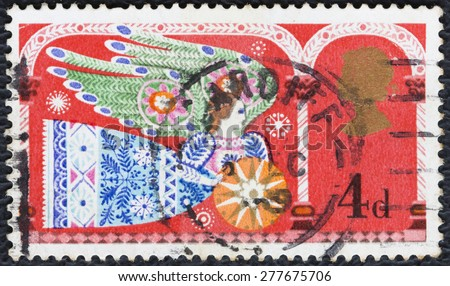 UNITED KINGDOM - CIRCA 1969: A stamp printed in England, shows an angel, Christmas, circa 1969. - stock photo