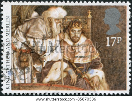 UNITED KINGDOM - CIRCA 1985: A stamp printed in England, shows Arthur consulting with Merlin, circa 1985