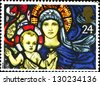 UNITED KINGDOM - CIRCA 1992: A stamp printed in Great Britain shows stained glass window of the Madonna and Child, St. Mary's Church, Bibury, circa 1992 - stock photo