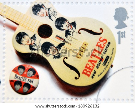 UNITED KINGDOM - CIRCA 2007: A stamp printed in Great Britain shows the Beatles memorabilia (guitar and pin), circa 2007.  - stock photo