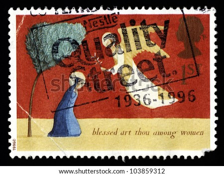 UNITED KINGDOM - CIRCA 1996: A stamp printed in the United Kingdom shows a christmas blessed art thou among women, circa 1996. - stock photo