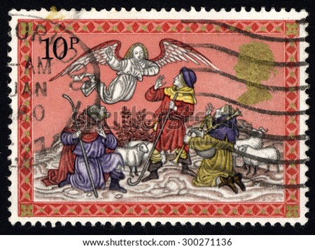 UNITED KINGDOM - CIRCA 1979: A stamp printed in the United Kingdom shows Angel appearing before the shepherds, Christmas, circa 1979  - stock photo