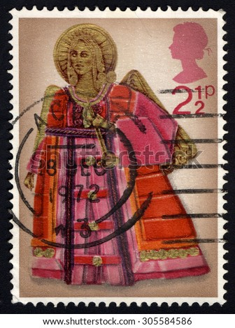 UNITED KINGDOM - CIRCA 1972: A stamp printed in the United Kingdom shows Angel with Trumpet, circa 1972. - stock photo