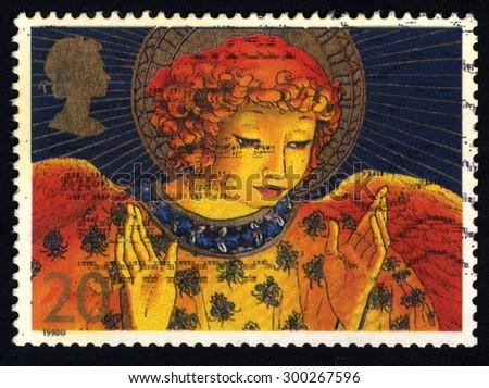 UNITED KINGDOM - CIRCA 1998: A stamp printed in the United Kingdom shows Christmas Angel, circa 1998  - stock photo