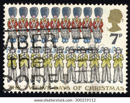UNITED KINGDOM - CIRCA 1977: A stamp printed in the United Kingdom shows Ten Pipers and Nine Drummers, circa 1977, circa 1977 - stock photo