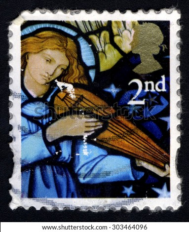 UNITED KINGDOM - CIRCA 2009: A stamp printed in the United Kingdom shows The Angel by William Morris, Church of St. James, Stavely, Kendal, circa 2009 - stock photo