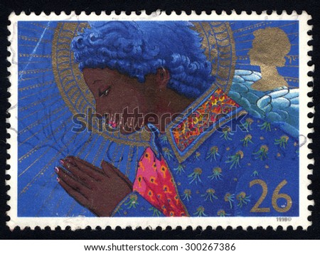 UNITED KINGDOM - CIRCA 1998: A stamp printed in the United Kingdom shows The Angel Praying, circa 1998. - stock photo