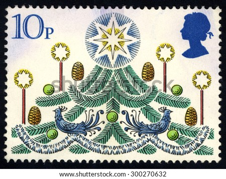 UNITED KINGDOM - CIRCA 1980: A stamp printed in the United Kingdom shows The Christmas Tree, circa 1980 - stock photo