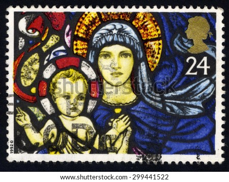 UNITED KINGDOM - CIRCA 1992: A stamp printed in the United Kingdom shows The Madonna and Child, St. Marys Bilbury.Christmas. Stained Glass Windows, circa 1992.