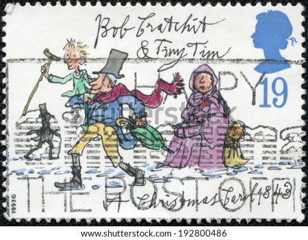"""UNITED KINGDOM - CIRCA 1993: A stamp printed in United Kingdom from the """"Christmas 150th anniversary of A Christmas Carol novel by Charles Dickens"""" issue shows Bob Cratchit and Tiny Tim, circa 1993. - stock photo"""