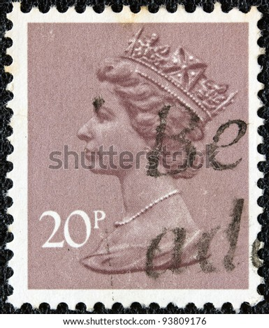 UNITED KINGDOM - CIRCA 1971: A stamp printed in United Kingdom showing a portrait of Queen Elizabeth II, circa 1971. - stock photo