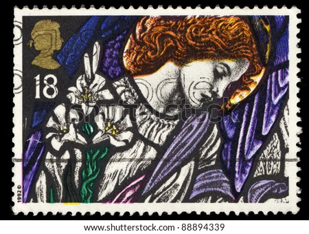 UNITED KINGDOM - CIRCA 1992: A stamp printed in United Kingdom shows Angel Gabriel on stained glass window, Christmas, circa 1992
