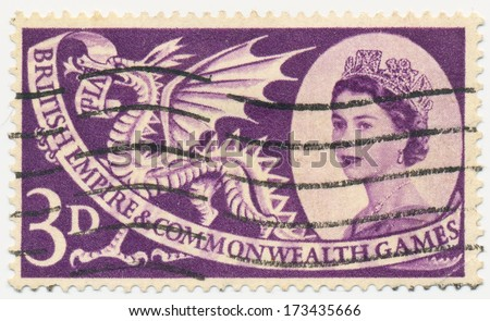 UNITED KINGDOM - CIRCA 1958: A stamp printed in United Kingdom shows portrait of Queen Elizabeth II and Welsh Dragon, circa 1958