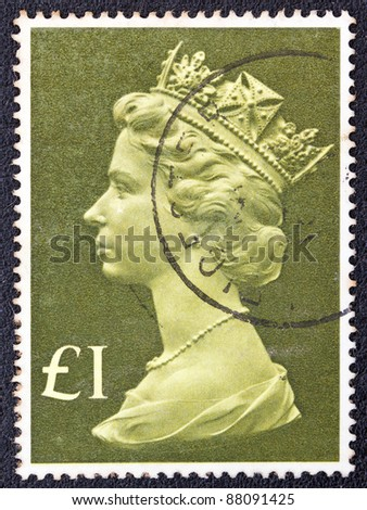 UNITED KINGDOM - CIRCA 1977: A stamp printed in United Kingdom shows Queen Elizabeth II, circa 1977. - stock photo