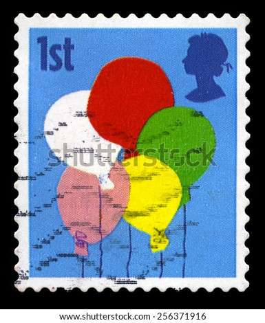 UNITED KINGDOM - CIRCA 2006: A used British Postage Stamp depicting a celebratory image of Balloons, circa 2006. - stock photo