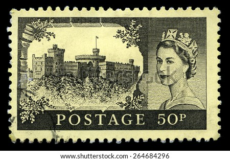 UNITED KINGDOM - CIRCA 1955: A used British postage stamp depicting a portrait of Queen Elizabeth II and Windsor Castle, circa 1955. - stock photo