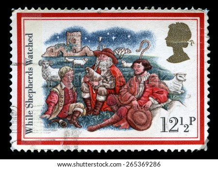 UNITED KINGDOM - CIRCA 1982: A used British postage stamp from the Christmas Carols series, showing While Shepherds Watched, circa 1982. - stock photo