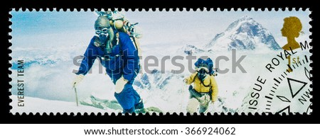 UNITED KINGDOM - CIRCA 2003: A used postage stamp printed in Britain celebrating British Explorers showing Members of the 1953 Mount Everest Team - stock photo
