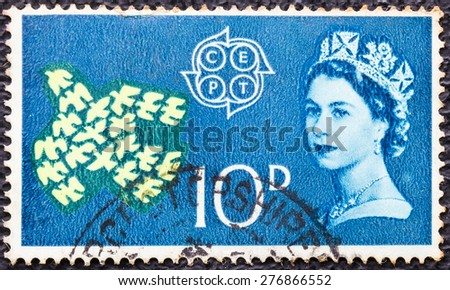 UNITED KINGDOM - CIRCA 1961: A vintage stamp printed in Great Britain shows Queen Elizabeth II, doves and CEPT Emblem (Conference of European Postal Telecommunications), circa 1961 - stock photo